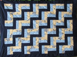Rail fence lap quilt