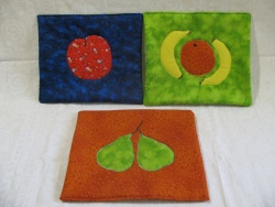 Trivets with fruit applique