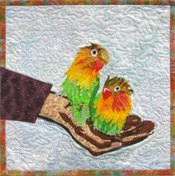 Love Birds in Hand fabric art