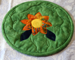 Insulated, applique trivet