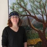 Cindy in front of Kibbutz quilt