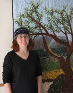 Cindy in front of Kibbutz quilt