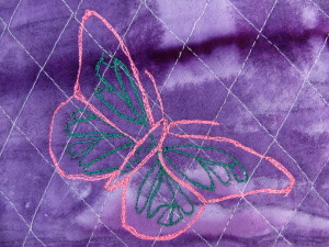 Embroidered Butterfly on purple bag