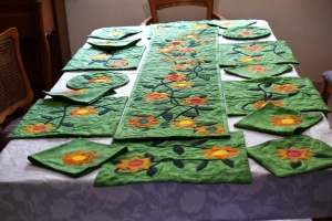 Vine with flowers insulated runner and trivets